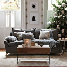 Gray sofa, tailored pillows, white shutters, candles...love.