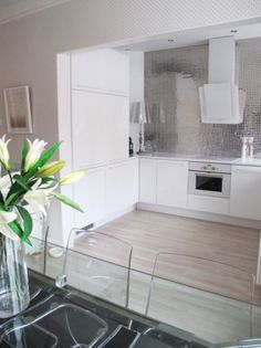 interior design, lights, white kitchen cabinets, artists, floors, lamp, kitchen counters, modern kitchens, white kitchens
