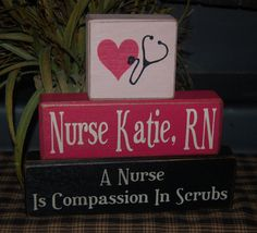 A NURSE Is Compassion In Scrubs RN Custom Personalized Name Wood Sign Shelf Blocks Primitive Country Rustic Home Office Decor Gift. $31.95, via Etsy.