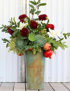 Another great option for tall arrangements for round tables at reception(with complementary flowers to the vision)  not necessarily the container although I do like it