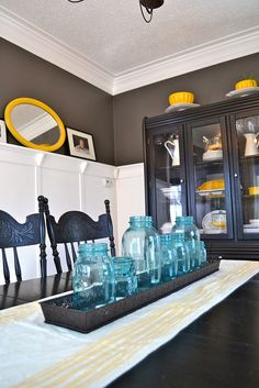 Beautiful slate and yellow dining room at Newly Woodwards. You HAVE to see the before!