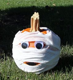 Making this cute mummy pumpkin is so simple! Soak a roll of gauze in Elmer's glue and water mixture; squeeze out excess. Wrap gauze around pumpkin, leaving space for the eyes and mouth. Glue eyes into place and draw mouth on with black Elmer's Painter. Voila! #elmers #craftit