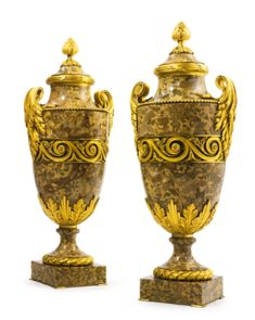 A VERY FINE AND IMPRESSIVE PAIR OF LOUIS XVI STYLE GILT BRONZE MOUNTED BRÈCHE BRUNE D'ASIE MINEURE MARBLE URNS  PARIS, CIRCA 1860S