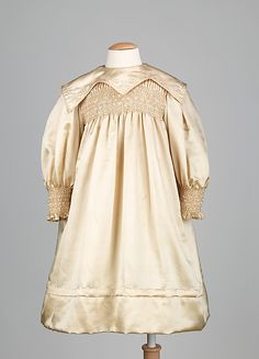 hand smocked silk child's dress ... Liberty of London, ca. 1900-1905