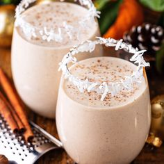 This authentic Coquito recipe is a Puerto Rican tradition that is loaded with coconut, rum, cinnamon and raisins for an extra thick and creamy coconut eggnog. #Coquito #Coconut #Eggnog #CoconutEggnog #PuertoRican #Christmas #Rum