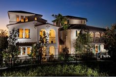 Lighted arches at twilight. The Bungalows at Pacific Shores. New townhomes by Christopher Homes. Huntington Beach, CA.