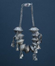 Neck jewelry, Indonesia, Sumatra, silvered hollow beads, silver pendant, clasp silver with copper appliqué, Jakarta. Photo courtest Arnoldsche Art Publishers