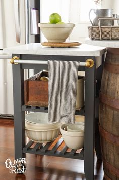 Ikea cart makeover (Bekvam kitchen cart $69.99 - paint, add granite top & vintage towel bar (made from etsy vintage brass towel holders from with a piece of electrical conduit). So clever.