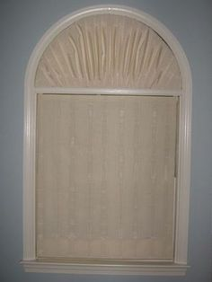Arch Window Covering - Finally found a cheap way to cover this arch! Styrofoam covered with fabric.