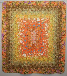 Beijing by Mario Alonso, 2011 FAOF.  Blooming nine patch quilt with copper thread.