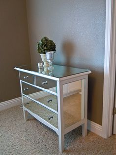 I would antique the mirrors and paint the white part silver but awesome DIY