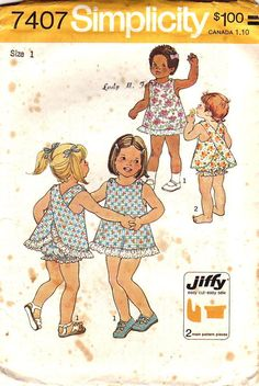 """Simplicity Pattern 7407 Vintage 70s Toddlers Jiffy Dress and Bloomers dated 1976. This includes; The lined """"one-piece"""" dress with shoulder straps criss-crossed in back and buttoned to front has matching bloomers with elastic casings at waistline and at leg edges, forming self ruffles. V. 1 has embroidered eyelet edging. V. 2 has rick-rack. size 1 AND 3"""