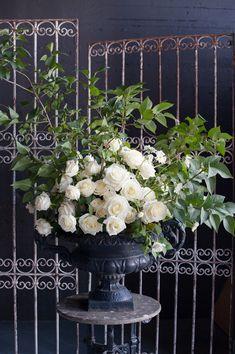 classic floral arrangement, photo by Jarusha Brown http://ruffledblog.com/black-gold-calgary-wedding #flowers #roses #wedding