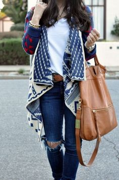 Cute outfit for fall - long layered knit sweater, ripped dark wash jeans, and plain white tee