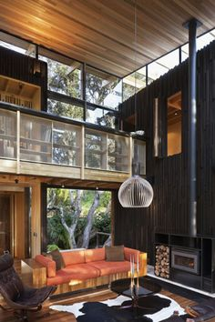 Natural Wood Interiors :: Living Room, Loft / Balcony, Vertical Dark Wood Wall, Light Wood ceiling, Wood Couch / Sofa, Large Glass Windows, Modern Fireplace, Fur Carpet.