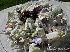 ~Apple Slaw~ is creamy, crunchy and an unique twist on an old favorite. It's the perfect side dish for any autumn picnic, party or even tailgating!
