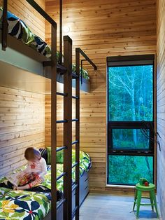 Modern Wooden Cottage Bunk Room in a Small Space