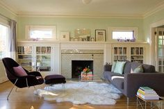 typical craftsman fireplace with built-ins on both sides and those little windows at the top.  Want to do this in our LR on the south wall with a gas insert.