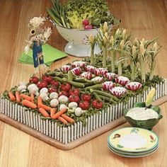 """An extra fun veggie platter! by Barbara Wellner via Taste of Home. So cute, I have a """"fence"""" thingy and will try to create a garden too."""