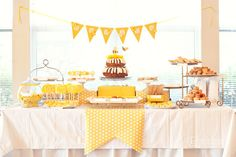 honey bee dessert table: boxes and table runner out of wrapping paper, all yellow + white desserts
