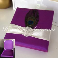 Peacock silk invitation box with hinged lid and large crystal brooch