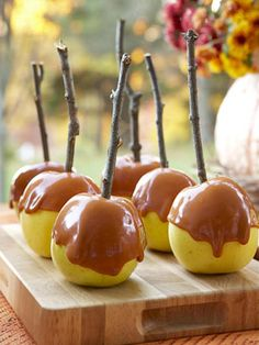 For caramel apples with grabbed-from-the-garden handles, trim twigs to four inches, wipe clean, and whittle one end down to a sharp point to insert