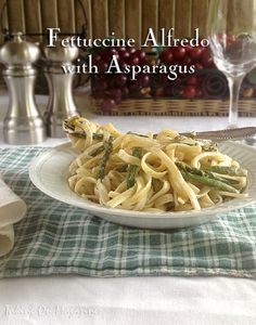 Fettuccine Alfredo with Asparagus | Taking On Magazines | www.takingonmagazines.com | A small amount of reduced-fat cream cheese replaces the heavy cream and turns this dish into a guilt-free, delicious meal.