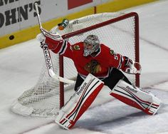 Blackhawks goalie Corey Crawford makes a save in the second period against the Red Wings.