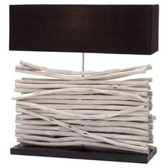 """Textured wood table lamp with a white wash finish and black shade.    Product: Lamp    Construction Material: Wood and fabric  Accommodates:  (1)  Bulb - not included  Dimensions: 24"""" H x 20"""" W x 8"""" D    Cleaning and Care: Wipe with dry cloth"""