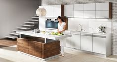 A designer kitchen with height-adjustable worktop  | TEAM 7
