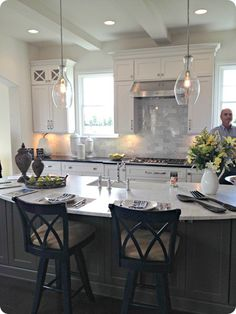 white cabinets gray island