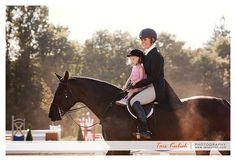 candid shot of mother and daughter at a horse show...precious