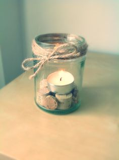 Cute little candle Old jar + twine + chopped up wine corks