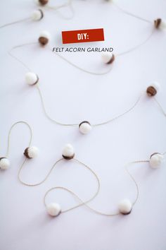 DIY Felted Acorn Garland - soooo cute!  Read more on #SMPLiving- http://www.stylemepretty.com/living/2013/12/21/diy-felted-acorn-garland/