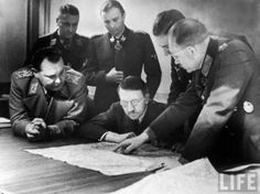 Guderian explaining the situation to the spectacled Fuhrer, next to Hermann Göring