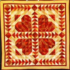 Scrappy Hearts quilt by Jane Love.  First place, small pieced quilts, 2013 Boise Basin Quilters Show.