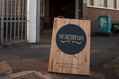 Love this factory cafe brown wooden sign logo branding.