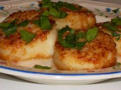 Sauteed Scallops with Garlic is a very old post, but it's still my absolute favorite way to cook scallops!  This recipe has a little flour, but I'm guessing you could substitute coconut flour or almond flour for browning the scallops.  [from Kalyn's Kitchen]