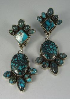 """Spiderweb Turquoise cluster clip-on earrings signed """"L. Ganado, Sterling"""", the hallmark of LaRose Ganadonegro. Possibly set with high grade Chinese turquoise?"""