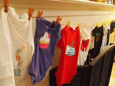 Have each guest bring a onesie reminiscent of their personality (or a memory with the mom-to-be) and have the mom-to-be guess who brought each one.