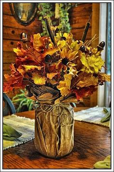Very inexpensive fall decor--paper sack, canning jar, and silk flowers