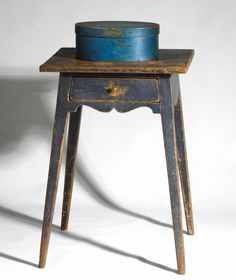 "c.1790-1810 S.E. Pennsylvania Seldom do we see Pennsylvania stands of such fine form and surface as this blue painted example with splayed legs, scalloped apron, drawer with original brass pull and wearing a wonderful early blue painted finish.    ~ ITEM DETAILS ~   Dimensions: H 28"", W 19 ½"", D 19 ¼""   Date / Circa: c.1790-1810   Maker / Origin: S.E. Pennsylvania   Medium: Pine with original paint history of blue over white"