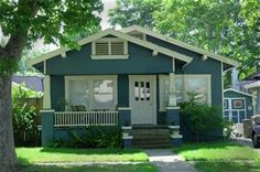 Imagine this home in a lovely craftsman green, with deep red window trim and door, and cream where it is now white.