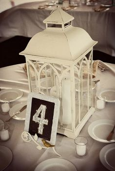 table decor, love the lantern, maybe add some mason jars with candles in them... table settings, lantern centerpieces, diy wedding centerpieces, country weddings, wedding flowers, rustic weddings, chalkboard, lanterns, table numbers