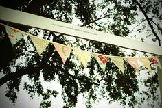 Pretty bunting handmade with love by the mother of the bride decorating the elegant arch by www.brisbaneweddingdecorators.com.au