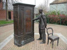 statue of C. S. Lewis and the famous wardrobe outside the public library in Belfast, Northern Ireland