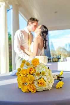 Bride and Groom with yellow and white wedding bouquet. {Yellow spray roses, billy balls, cream hydrangea}