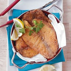 Natalie's Cajun-Seasoned Pan-Fried Tilapia | Flavor budget-friendly tilapia fillets with Cajun (or Creole) seasoning, dredge in flour and cornmeal, and pan fry for a quick-cooking weeknight meal. | SouthernLiving.com