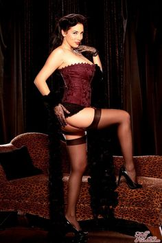 Jelena Jensen in vintage maroon corset with maroon stockings