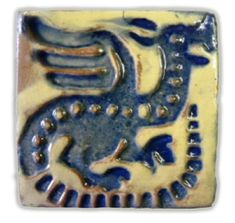 """""""The Scaled Dragon"""" tile was made at the Moravian Pottery  Tile Works and designed by Henry Chapman Mercer c. 1900s based on an English medieval tile. This tile is in the MPTW collection and is projected to have been produced at the tile works circa 1920s to 30s."""